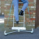 Anchor-Fix widens the ladder's base and helps stability on sloping ground